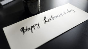 Lycklig kalligrafi för dag för arbete` s och lattering vykort Vänstersidasikt Royaltyfri Foto
