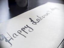 Lycklig kalligrafi för dag för arbete` s och lattering vykort Vänstersidasikt Arkivbild