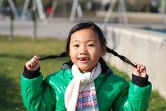 lycklig kinesisk flicka little Fotografering för Bildbyråer