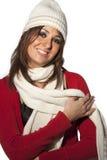 Lycklig kläder för ull för vinter för frisyrmodellkvinna på vit Royaltyfria Foton