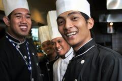 lycklig kockgrupp Arkivfoto