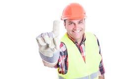 Lycklig konstruktör som pekar fingret eller visar nummer ett Royaltyfria Bilder