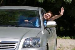 lycklig kvinna för bil Arkivbilder