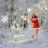 lycklig kvinna för jul Arkivbild