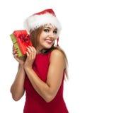 Lycklig kvinna för jul i santa den röda hatten Arkivfoto