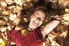 Lycklig kvinna för Smiley som tycker om Fotografering för Bildbyråer