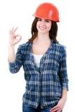 Lycklig kvinna i byggmästarelikformig Royaltyfria Bilder