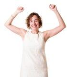 Lycklig kvinna i den vita klänningen Fotografering för Bildbyråer