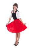 Lycklig kvinna i typisk bavarianklänningdirndl Royaltyfri Foto