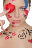 Lycklig kvinna med framsidakonst på tema av Frankrike Arkivfoton