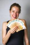 Lycklig kvinna med mycket pengar Arkivbilder