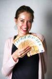 Lycklig kvinna med mycket pengar Arkivfoto