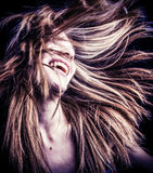 Lycklig kvinna med vind blåst hår Arkivfoton