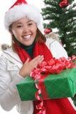 Lycklig kvinna på jul Royaltyfria Bilder