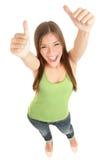 Lycklig kvinna som ger upp tum Arkivbilder