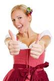 Lycklig kvinna som rymmer upp båda tummar Arkivbilder