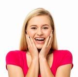 Lycklig kvinna som skriker mot vit bakgrund Fotografering för Bildbyråer