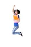 Lycklig kvinnlig deltagarebanhoppning med en anteckningsbok Royaltyfri Foto