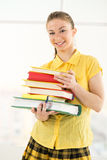 Lycklig kvinnlig student med böcker royaltyfria bilder