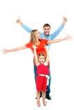 Lycklig le familj av tre som har gyckel Royaltyfri Foto