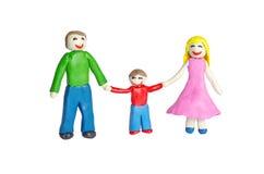 Lycklig le familj från lera Fotografering för Bildbyråer