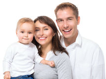 Lycklig le familjstående Royaltyfri Bild