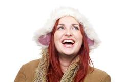 Lycklig le kvinna i vinterkläder Fotografering för Bildbyråer