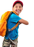 Lycklig le pojke med ryggsäcken som isoleras över vit Arkivbild