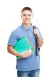Lycklig le student med hans anteckningsbok och ryggsäck arkivfoto