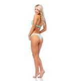 Lycklig le ung kvinna i bikinibaddräkt royaltyfria bilder