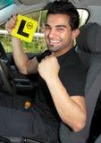 lycklig learnermanlig för chaufför fotografering för bildbyråer