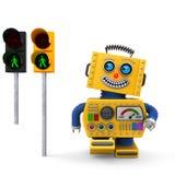 Lycklig leksakrobot som går på trafikljus Arkivfoton