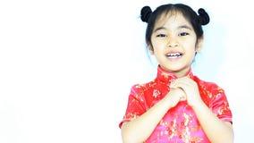 Lycklig liten asiatisk kinesisk barnhälsning