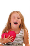 Lycklig liten flicka med en gåva för St.-valentin dag Arkivfoto