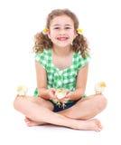 Lycklig liten flicka med hönor Arkivbild