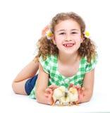 Lycklig liten flicka med hönor Royaltyfria Foton