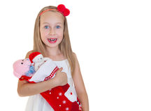 Lycklig liten flicka med julklappar Arkivfoton