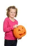 Lycklig liten flicka med pumpa Arkivfoto