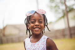 Lycklig liten flicka som firar 4th Juli Arkivbild