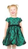 lycklig liten stående för härlig flicka arkivbild