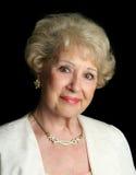 lycklig lyckad ladypensionär royaltyfria bilder