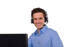 Lycklig lyckad ung affärsman med anteckningsboken och hörlurar med mikrofon Fotografering för Bildbyråer