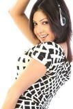 lycklig lyssnande musik till kvinnan Fotografering för Bildbyråer