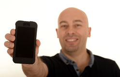 Lycklig man med mobilen Royaltyfria Bilder