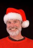 Lycklig man på jul Arkivbild