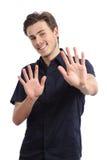 Lycklig man som kasserar och gör en gest stoppet med händer Arkivbild