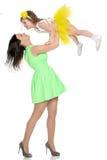 Lycklig moder som rymmer en ung dotter Royaltyfri Bild