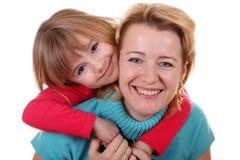 lycklig moderstående för dotter Arkivbild