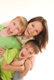 Lycklig mom och barn Arkivfoto