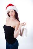 Lycklig nätt ung kvinna med gåvapåsen Fotografering för Bildbyråer